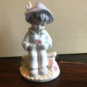 Boy sitting on rock, thinking vintage figurine